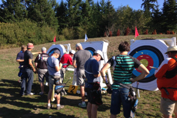 Participants retrieving arrows from target butts during 720/900 Round - September 28, 2014