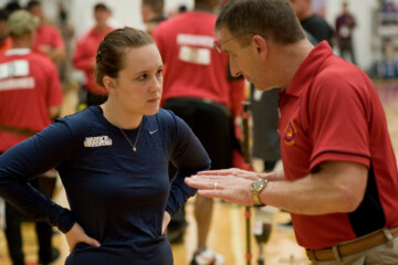 Brian Ficker, an official judge from the National Archery Association advises Judith Boyce during the archery competition at the inaugural Warrior Games at the Olympic Training Center in Colorado Springs.